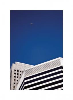 Flight Above The Buildings in Blue