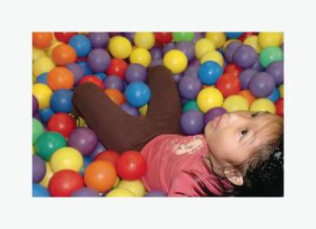 kid with the colorful balls