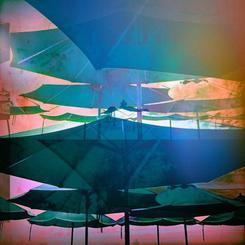 Umbrellas in a Technicolor Sky