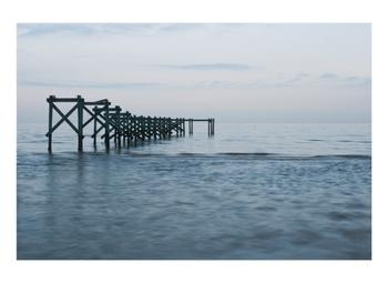 Sea, Sky and Geometric Shapes of Pier Remnants