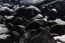 boys and rocks by Juliano Lamb