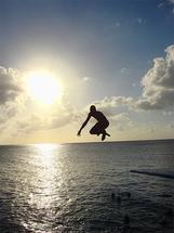Young jumping by Juliano Lamb