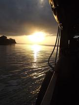 boat and sun by Juliano Lamb