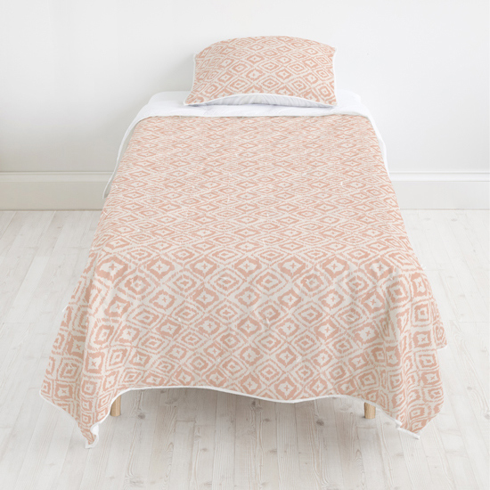 - Painterly Ikat quilt + Painterly Ikat sham by Minted Artists