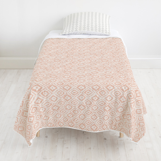 - Painterly Ikat quilt + Folk Dots sham by Minted Artists