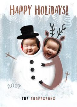 A snowman and a Reindeer