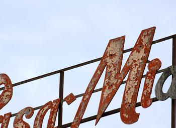 A weathered sign