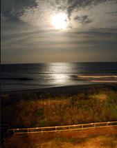 Moonrise over the Atlan... by Ashley Slade Mast